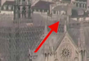 webcam catches unknown person on notre dame roof and a flash before the fire