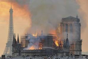 france honors notre dame firefighters; protects rose window