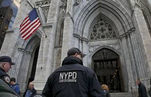man caught walking into new york cathedral with full gas cans, lighters