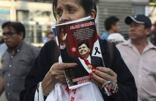 'a decision of dignity and honour': peruvians mourn ex-leader garcia after he shot himself to ...