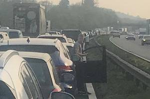 chaos on m5 after coach and car crash - live updates