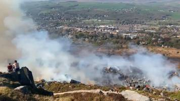 ilkley moor fire 'rapidly spreading' after rising temperatures
