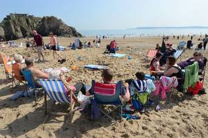 walkers left stranded at sea by the incoming tide in tenby on easter saturday