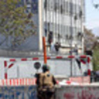 at least 7 die as gunmen storm high-rise in kabul, trapping workers for hours