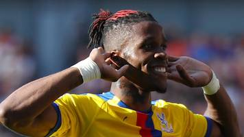 wilfried zaha is happy at crystal palace, says roy hodgson