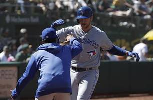 smoak nabbed after laureano overthrow, but jays sweep a's