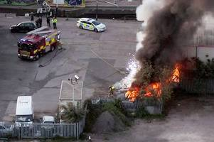 sparks fly from burning cars in dramatic drone footage of fire at frog island
