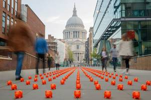 thousands of little orange piggy banks have been dropped in major uk cities - and it's all because of this gloucester-based company
