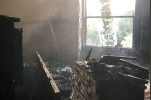Devastating pictures show damage from major house fire sparked by a MIRROR