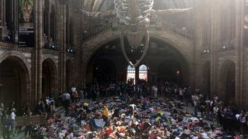 uk climate protesters stage museum 'die-in'