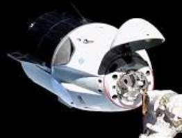 1st manned flight of crew dragon to iss postponed due to accident