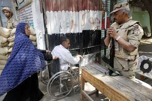 egypt referendum: government accused of using bribes and threats to force voters to support sisi