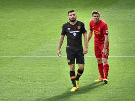premier league: liverpool's james milner cheering on manchester united