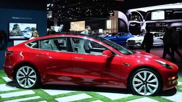 tesla's elon musk expects 'robotaxis' to start in us next year