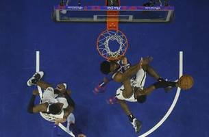 simmons, embiid usher 76ers past nets and into 2nd round
