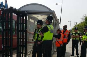 police scan bus passengers for knives as arches set up at oldbury station