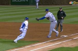 javier baez reaches first safely after making david freese miss