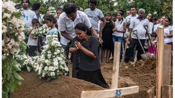 sri lanka attacks: death toll revised down by 'about 100'