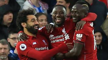 liverpool thrash huddersfield to regain premier league top spot