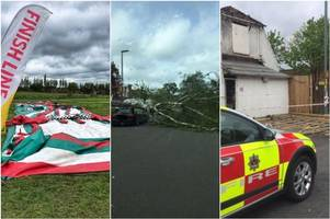 storm hannah chaos in birmingham - tree crashes on car, roads blocked, roof torn from building and inflatable run axed