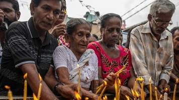 sri lanka bombings: faithful meet outside church