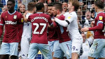 leeds score controversial opener with player down injured then let villa equalise unchallenged