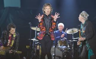 jagger doing really well' according to ronnie wood
