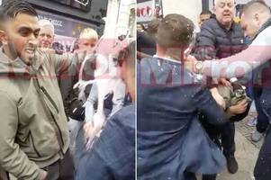 Tommy Robinson throws punches after McDonald's milkshake thrown on head