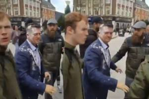 Far-right activist Tommy Robinson hit by milkshake TWICE while campaigning