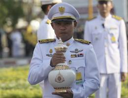 Tiered golden crown, sceptre and sacred water: the Thai king's coronation