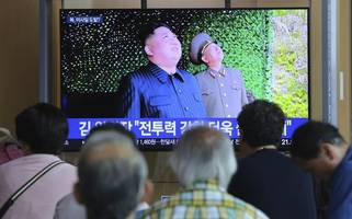 kim jong un praises 'long-range' rocket tests as trump administration claims they were 'relatively short range' weapons