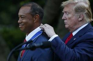 the latest: trump awards medal of freedom to tiger woods