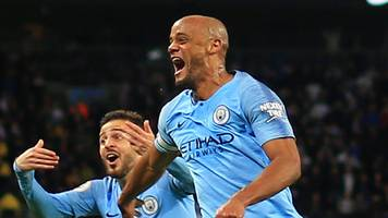 kompany's stunning goal puts man city on brink of title
