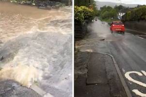 high street closed in merthyr as road floods and begins to fall apart