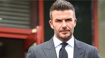 David Beckham banned from driving for using mobile phone