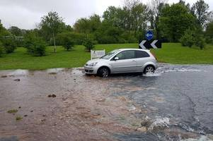 watch - raging torrent as schools closed and more than 1,000 homes without water as warwick highway, redditch, flooded