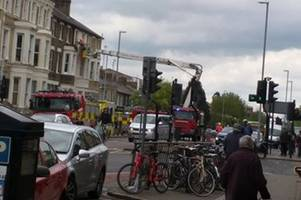 first pictures show fire crews responding to mitcham's corner emergency