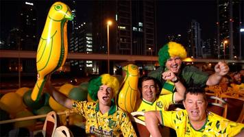 norwich city ex-pat fans hold bus parade in dubai