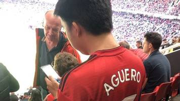 the man united fan with man city's aguero on his replica shirt?