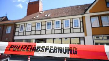 crossbow german deaths: two shot through heart, one in neck