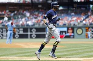 yelich goes deep twice, brewers beat phillies 11-3