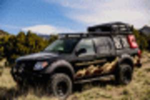 overlander nissan frontier truck has its compass pointed to the middle of nowhere