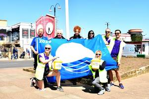 bbc presenter james piekos walks into cleethorpes to unfurl blue flag and tuck into fish and chips on 100-mile charity trek