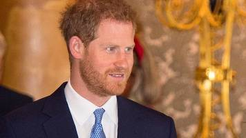 prince harry accepts damages over splash news agency photos