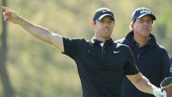 McIlroy faces anxious wait after battling second round at Bethpage