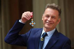rebel, rebel! springwatch presenter chris packham dons extinction rebellion tie to pick up his cbe from eco-friendly prince charles at the palace