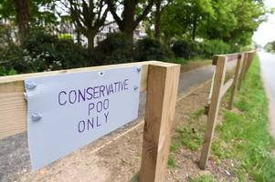 mysterious sign about 'conservative poo' appears in newmarket