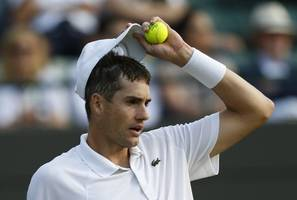 isner out of french open with injury; ends 24-slam streak