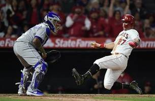 Trout, Pujols back Harvey and lift Angels over Royals 5-2