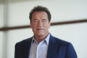 arnold schwarzenegger drop-kicked in the back during sporting event in south africa (video)